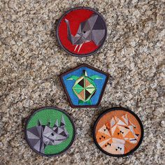 Save the Critters Badge Pack. Endagered species on patches by Cub Cubs. elephant, rhino, leopard turtle. Colour, fabric.