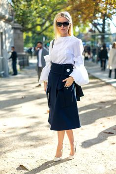 Put a twist on the classic white shirt and pencil skirt combo by opting for a shirt with statement-making sleeves and a skirt with a little flair.