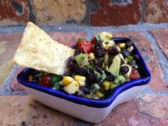 Take advantage of fresh summer produce and whip up this delicious Black Bean Salsa Recipe with fresh corn.