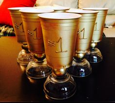 Home made beer pong/ flip cup trophies! Solo cup + ping pong ball + dollar store bowl + gold spray paint and puffy paint :)