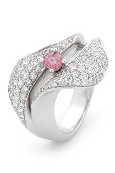 Argyle Diamonds Collection: Kimberly Fine Diamonds. A statement Argyle pink diamond ring, by Kimberley Fine Diamonds. A 0.25 carat round brilliant Argyle pink diamond surrounded by white diamonds totalling 0.93 carats, set in white gold.