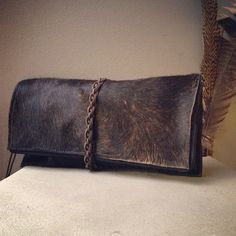 Brindle Hair on Hide Brindle Leather Clutch, hand braided detail by Bull Horn Designs. Braid Braided Bag Purse Western Minimal Natural Beauty Fashion Woven Textile Made In the USA
