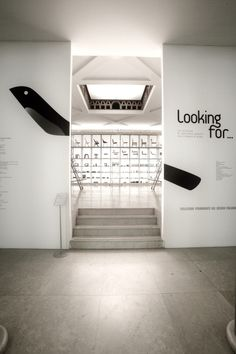 Looking For Exhibition by Stefano Polli, via Behance Signage Light, Window Signage, Exhibition Booth Design, Exhibition Display, Environmental Graphic Design, Environmental Graphics, Wayfinding Signage, Signage Design, Display Design