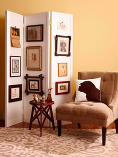 Create a Rotating GalleryDisplay vintage finds in a unique way by making a rotating gallery. By hanging vintage pictures, such as these antique dog pictures, along a folding screen, you can change the display without adding holes to the walls. A folding screen also is a smart way to divide a room or conceal storage.