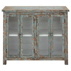 Wood cabinet with glass doors and a distressed painted finish in blue.  Product: CabinetConstruction Material: W...