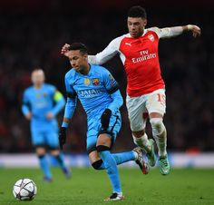 Neymar of Barcelona holds off the challenge from Alex Oxlade-Chamberlain of Arsenal during the UEFA Champions League round of 16, first leg match between Arsenal FC and FC Barcelona at the Emirates Stadium on February 23, 2016 in London, United Kingdom.