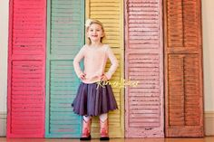 salvage old shutters with a quick paint job and use as and indoor or outdoor photography back drop!