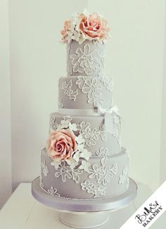 Grey wedding cake with brush embroidery and pink roses