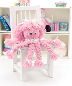 Easy enough to make with a child, this clever octopus is a great way to practice making braids. There's no knitting or crocheting! Be creative and use a favorite color of yarn and trims.