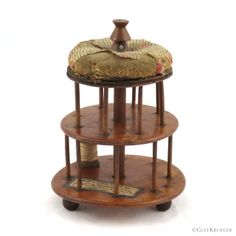 """Cut an carved wood spool holder with printed floral pinstripe covered pincushion on top, above two turned discs of birdseye maple with 16 pins for spools, c. 1800, 6.5"""" h. Includes full genealogy. Jonathan Mabbett, son of Joseph Mabbett, Jr., and Sarah Baron, was born at Nine Partners, NY, in 1762. The land belonging to his father and uncle Samuel was the site upon which the original Nine Partners Meeting House was built. Jonathan was a Quaker preacher and a strong business man. He was a suc Spool Holder, Wood Spool, Birdseye Maple, Baron, Carved Wood, Glee, Pin Cushions, Genealogy, Joseph"""