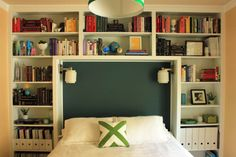 Over-bed book storage; pretty & practical (though maybe not very restful.) Nice for a guest room or where space is really limited.