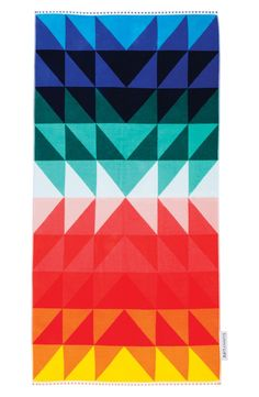 A must-have for summer! This eye-catching geometric print in bold colors covers an ultrasoft beach towel cut from pure cotton.