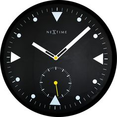 3049 - Serious Black. This NeXtime bold, black clock design with convex glass has an interesting avionic look, slightly reminiscent of the dials found on cockpit instruments.