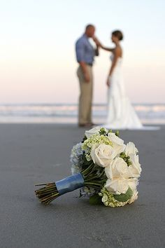 Wedding on Folly Beach.  Wedding by A Charleston Beach Wedding. Photography by Cori Carpenter.