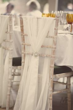 Chair decor with Ivory chiffon wraps by Debonair Venue Styling