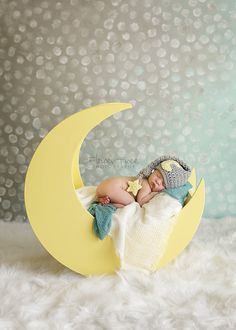 This little one looks so sleepy in their new moon and star hat! This hat is gray with a yellow moon and star.I can make your hat a different