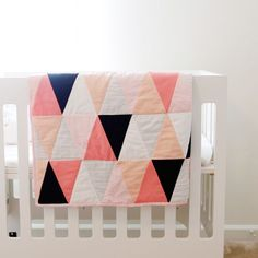 The triangles are a decent size, so it doesn't take forever and it's simple quilting. So, if you've never made a quilt before, this could be a great project for you! (And if you have quilted, it's still a fun project!)