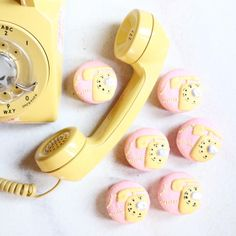 I'm a sucker for all things vintage, so it's no surprise I love a good rotary phone. {{ yellow rotary phone macarons }}