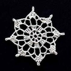 Crochet Snowflake #5. lots of flakes here.