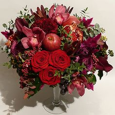 Ruby rose, orchid, berry, apple & pomegranate centrepiece