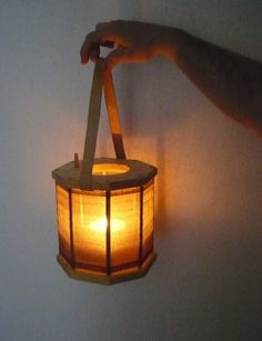 Medieval wood lantern. Make it collapsible and toss in an electric tea light...?