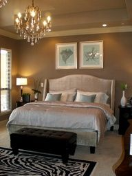Chandelier in bedroom!  Slate blue, beige and zebra print