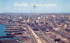 """Seattle Washington Aerial view of metropolitan area featuring the waterfront and the new multi-million dollar freeway system."" 1953. Via Vintage King County Washington."