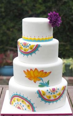 Great decor, white fondant layer cake with colored paisley