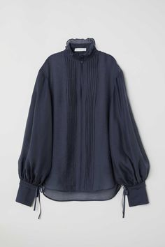 Blouse in an airy, woven Tencel® lyocell blend. High stand-up collar with pin-tucks, ruffle trim, and covered buttons. Photos Of Dresses, Latest Fashion For Women, Womens Fashion, Stylish Dresses For Girls, Blouse Models, Casual Tops For Women, Sustainable Clothing, Minimal Fashion, Ethical Fashion