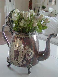 gotta find me a vintage silver teapot!
