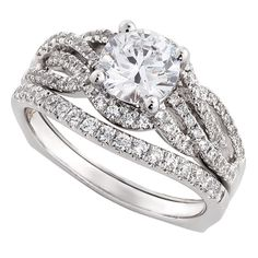 Ikuma Canadian diamond two-piece wedding set with a 1 carat center diamond. Other non-Ikuma diamonds total an additional 1/2 carat weight. This bridal set is in 14K white gold. <b>All Ikuma diamonds originate from North America and are mined in Canada.</b> American Gem Society (AGS) documentation provided on center Ikuma diamond.