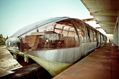 A train at an abandoned monorail station platform by Lusker 41 Abandoned Buildings, Abandoned Places, Abandoned Train, Locomotive, Namba Parks, Japan Train, Trains, Universal Studios Japan, Japan Guide