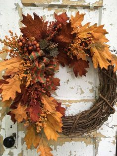 Fall Wreath, Autumn Wreath for Front Door, Fall Front Door Wreath, Autumn Decor This Fall wreath is filled with beautiful rich Fall colors. These high quality leaves, berries, Fall accents, plaid bow and twig pumpkin come together as a warm and vivid Autumn accent wreath that will enhance your front door. Please protect this wreath from the outdoor elements. The finished size is 22 x 22 x 9 from tip to tip. Thank you for visiting my shop