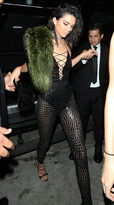 Kendall Jenner Birthday: low-cut, lace-up, semi-sheer jumpsuit with a black bodysuit and green fur stole