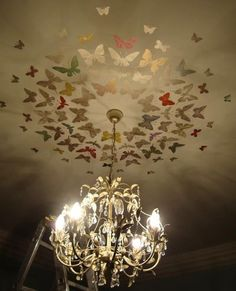 Butterflies stenciled~ great idea for the girl's bedroom's!  Love this..I stuck coloured card butterflies to the children's ceiling 15 years ago! Recently found them in the loft :-)