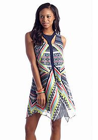 The colorful pattern on this shift dress makes it a great part of any warm-weather outfit. The yoke cut outs add to the style.
