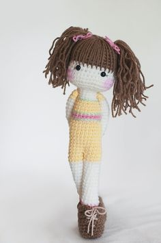 Light brown-haired crochet doll with yellow, pink, and green outift... and matching boots. via Etsy