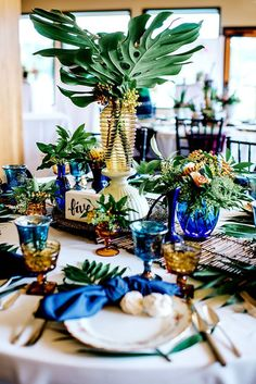 Tropical Wedding Table Decorations: A creative centerpiece mimicks a palm tree, . Tropical Wedding Table Decorations: A creative centerpiece mimicks a palm tree, with a yellow glass vase and palm leaves. Wedding Table Decorations, Wedding Table Settings, Wedding Table Numbers, Decoration Table, Wedding Themes, Wedding Colors, Wedding Ideas, Wedding Inspiration, Wedding Details