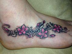 Live laugh love cherry blossom foot tattoo