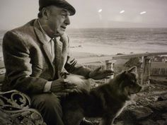 Pablo Neruda and his dog in their house by the sea.
