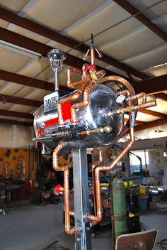 Steampunk mailbox made from a seven-gallon propane tank.