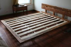 Reclaimed wood bedframe with hairpin legs