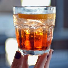 A bourbon-Aperol drink with honey and lemon juice. Photo: Axel Koester for The New York Times
