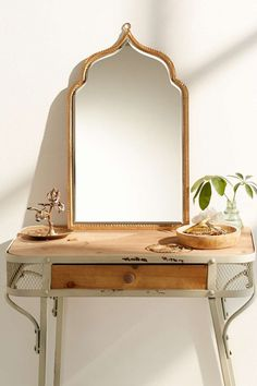 Urban Outfitters Taj Wall Mirror ($64):27 Cool but Grounded Gift Ideas for Your Taurus Friend via Brit + Co