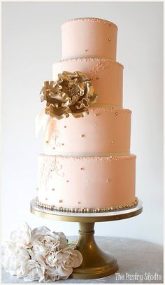 So gorgeous! Ballet Pink Wedding Cake by The Pastry Studio, Daytona Beach, Florida, USA, with Gold leaf metallic focal flower and classic Pearls. Found on Cake Appreciation Society FB Page.