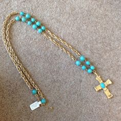 "Gold and Turquoise Long Necklace. NWT Gold cross with turquoise stones throughout. Measures 38"" Boutique Jewelry Necklaces"
