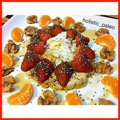 Delicious apple and cinnamon pancake topped with fresh strawberries, chia seeds, coconut flakes & maple syrup. On the side are activated raw walnuts and mandarin pieces. Paleo, gluten, dairy and sugar free.  A great start to the day! #breakfast #pancake #