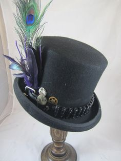 New design for 2014, Steampunk Felt Mens Black Bell Top hat with black bullet belt, peacock feather & pheasant pheasant feathers, with Clock Parts.