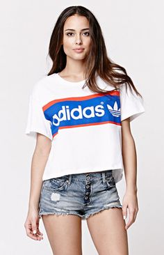 """The women's City Tee by Adidas for PacSun and PacSun.com offers a crew neckline and graphic on the front. We love the oversized fit and slightly cropped cut. Wear this t-shirt with our high waisted denim and sneakers!   22"""" length 6.5"""" sleeve length Measured from a size small Model is 5'9"""" and wearing a small Machine washable Made in USA"""