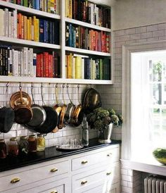 such a snazzy cookbook shelf and those pans....swoon!